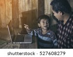 son pointing to laptop screen ... | Shutterstock . vector #527608279