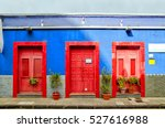 blue house with three red doors ...   Shutterstock . vector #527616988