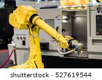 industrial robot with cnc achine | Shutterstock . vector #527619544