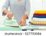 closeup of woman ironing... | Shutterstock . vector #527753086