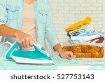 closeup of woman ironing... | Shutterstock . vector #527753143