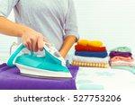 closeup of woman ironing... | Shutterstock . vector #527753206