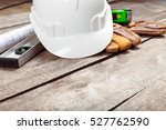 hardhat and old leather gloves | Shutterstock . vector #527762590
