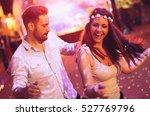 Small photo of Happy couple dancing in club