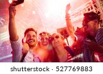 cheerful friends partying in... | Shutterstock . vector #527769883