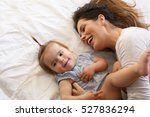young mother playing with her... | Shutterstock . vector #527836294