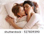 mother with her daughter ... | Shutterstock . vector #527839390