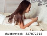 girl resting on the bed. happy... | Shutterstock . vector #527872918