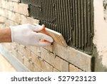 installing the tiles on the... | Shutterstock . vector #527923123