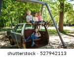 group of children on a swing.... | Shutterstock . vector #527942113