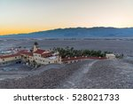 Sunset dusk at Furnace Creek Resort in Death Valley National Park with mountains in the background, and the hotel