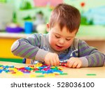 cute kid with down's syndrome...   Shutterstock . vector #528036100