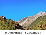 traditional swiss chalets in... | Shutterstock . vector #528038314