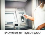 woman hand enter number on atm... | Shutterstock . vector #528041200