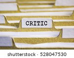 Small photo of Critic word on card index paper