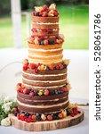 round multi tiered wedding cake ... | Shutterstock . vector #528061786