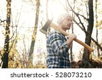 man with axe in the forest   Shutterstock . vector #528073210