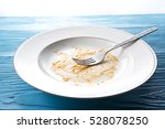 dirty and empty dishes on...   Shutterstock . vector #528078250