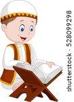 cartoon boy reading quran | Shutterstock .eps vector #528099298