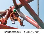 workers working at height to... | Shutterstock . vector #528140704