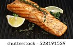 grilled salmon on grill closeup ... | Shutterstock . vector #528191539
