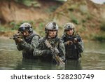 military squad crossing the... | Shutterstock . vector #528230749