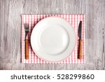 empty plate and cutlery on the... | Shutterstock . vector #528299860