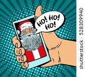 ho  ho  ho  male hand holding a ... | Shutterstock .eps vector #528309940