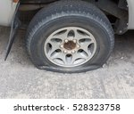 flat tires  car wheels in the... | Shutterstock . vector #528323758