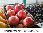 pomegranates on the market  | Shutterstock . vector #528336073