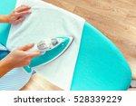 closeup of woman ironing... | Shutterstock . vector #528339229