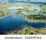 the okavango delta in botswana... | Shutterstock . vector #528349564