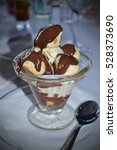 profiteroles with chocolate... | Shutterstock . vector #528373690