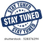 stay tuned. stamp. blue round... | Shutterstock .eps vector #528376294