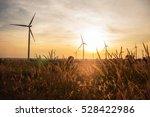 Prairie Wind turbines and solar morning. - stock photo