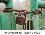 Rusty Lock Keeping A Fence...