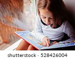 toddler girl with book near the ... | Shutterstock . vector #528426004