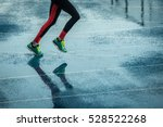 young woman running on track in ... | Shutterstock . vector #528522268