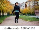 woman feet jumping  using... | Shutterstock . vector #528563158