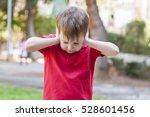 Little Caucasian Boy Closing...
