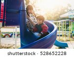 Boy And Girl On The Playground
