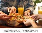 friends taking slices of tasty... | Shutterstock . vector #528662464