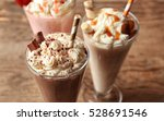 Delicious Milkshakes On Wooden...
