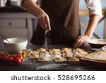 woman making ravioli on table | Shutterstock . vector #528695266