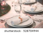 White Napkin With Golden Ribbo...