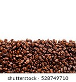 roasted coffee beans on white... | Shutterstock . vector #528749710