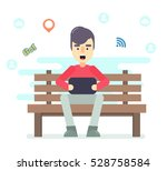 young man sitting in the park... | Shutterstock .eps vector #528758584
