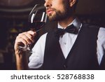 concentrated sommelier inhaling ... | Shutterstock . vector #528768838