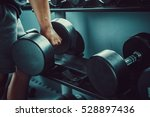 strong man's hand takes a heavy ... | Shutterstock . vector #528897436