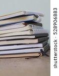 stack books on a wooden deck... | Shutterstock . vector #528906883